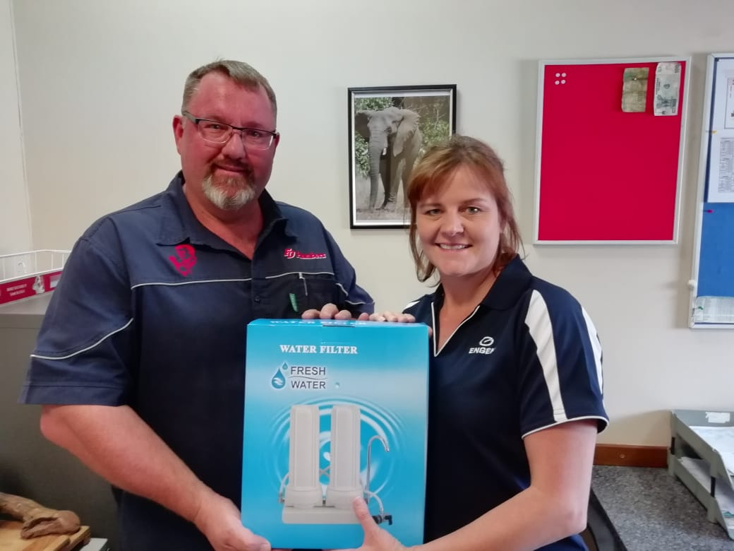 The handing over the prize to our two stage water filter competition winner.